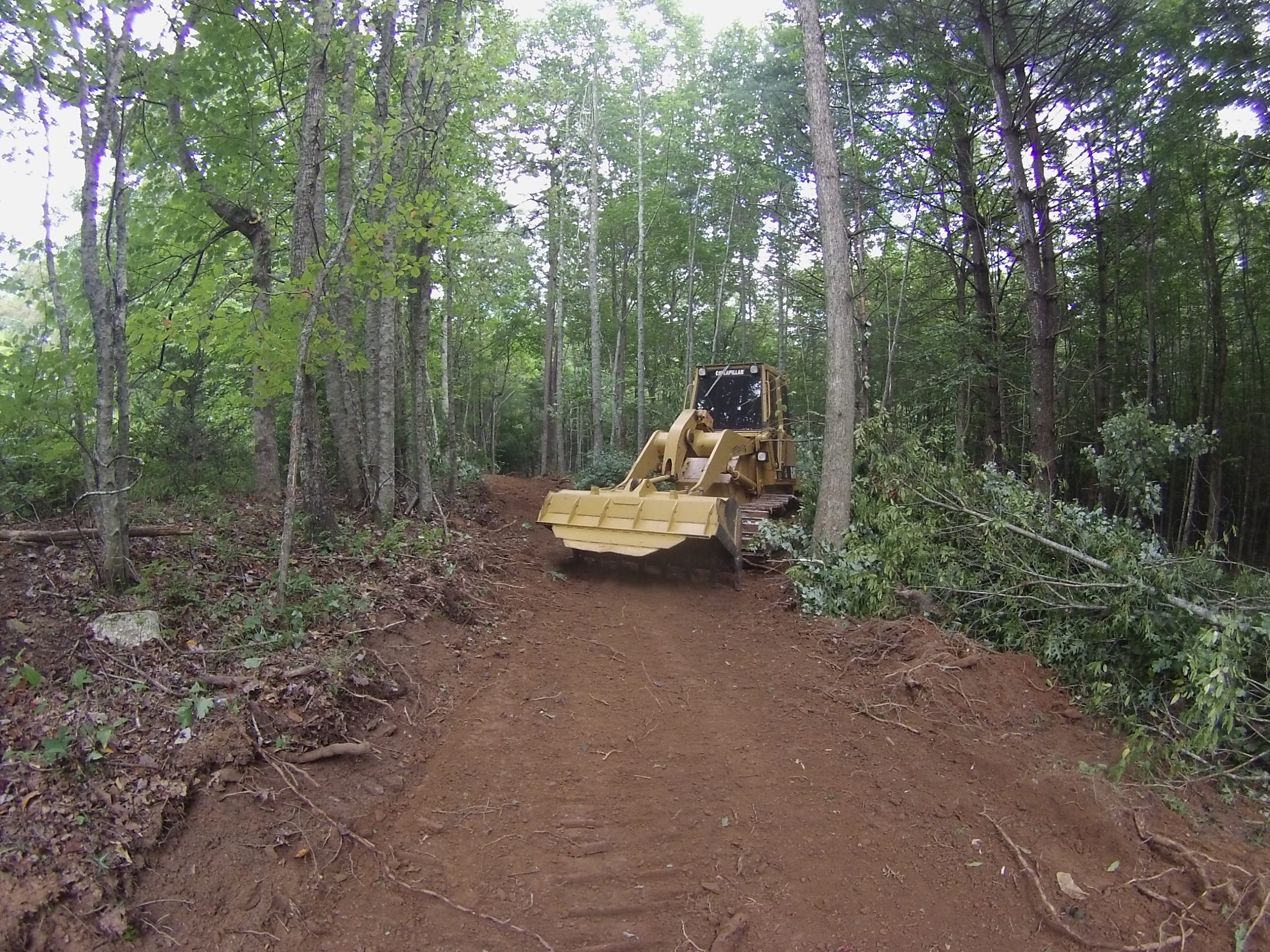 Land clearing, grading and drainage pipe